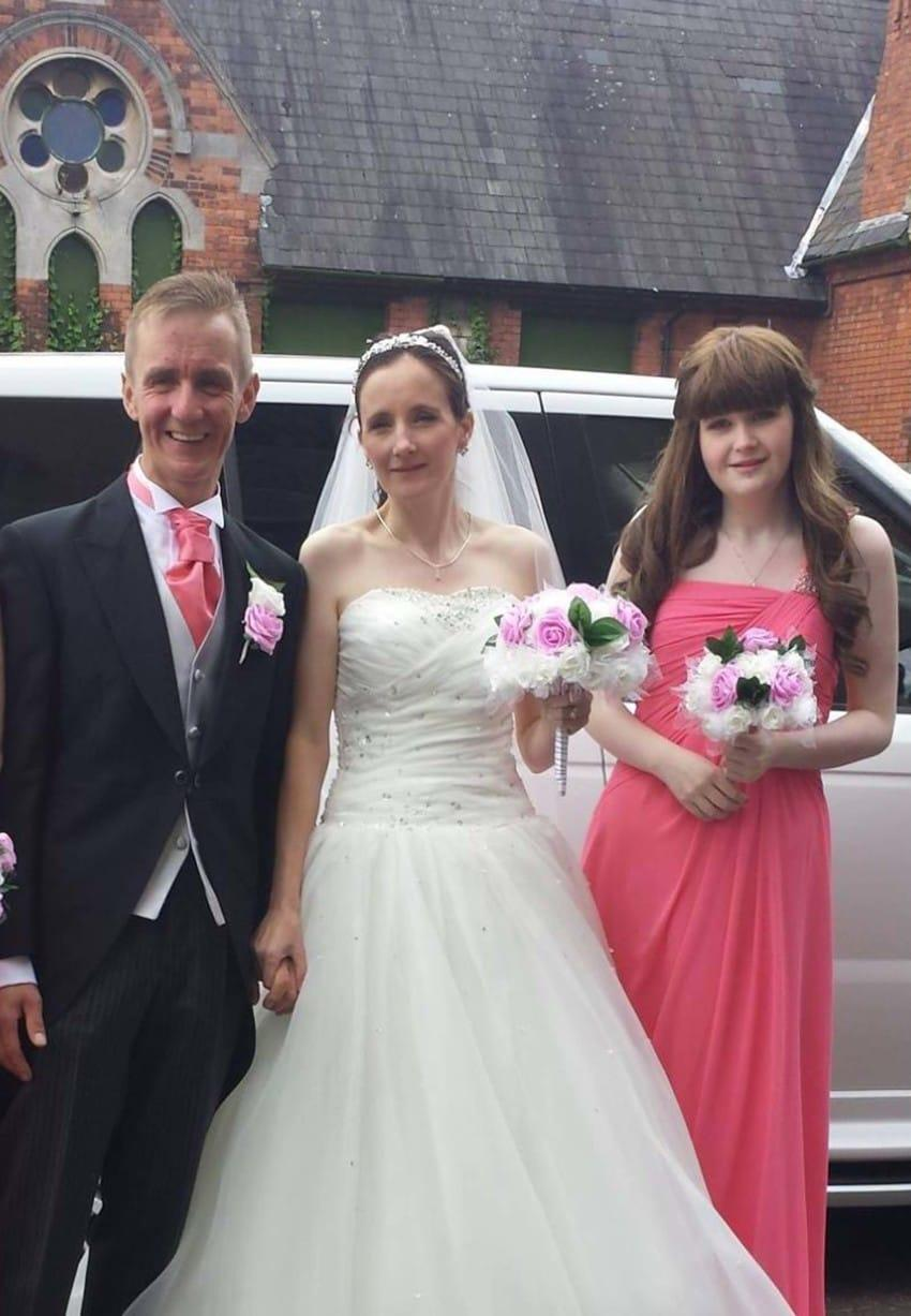 PIC FROM MERCURY PRESS (PICTURED: SARAH DANBURY, 39, WITH HER HUSBAND ADRIAN AND DAUGHTER AMY BECKINGHAM, 19)A grieving mum claims to have caught her dying daughters GUARDIAN ANGEL on camera in the pairs poignant final photo together.Sarah Danbury from Grantham, Lincs, was in London with 19-year-old daughter Amy Beckingham as she underwent a clinical trial to battle an ultra-rare liver cancer at Royal Free Hospital in London.They were staying at a nearby hotel and were messing around taking selfies together to show Sarahs husband Adrian what the room was like when she captured the heavenly apparition.Amy was convinced the shape was her guardian angel come to watch over her and she sadly passed away just three weeks later. SEE MERCURY COPY